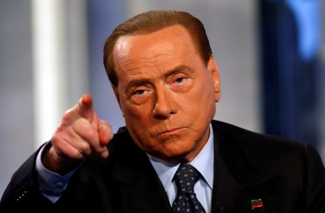 "Italy s former Prime Minister Silvio Berlusconi gestures as he attends television talk show ""Porta a Porta"" (Door to Door) in Rome, Italy, November 30, 2016. REUTERS/Remo Casilli     TPX IMAGES OF THE DAY"