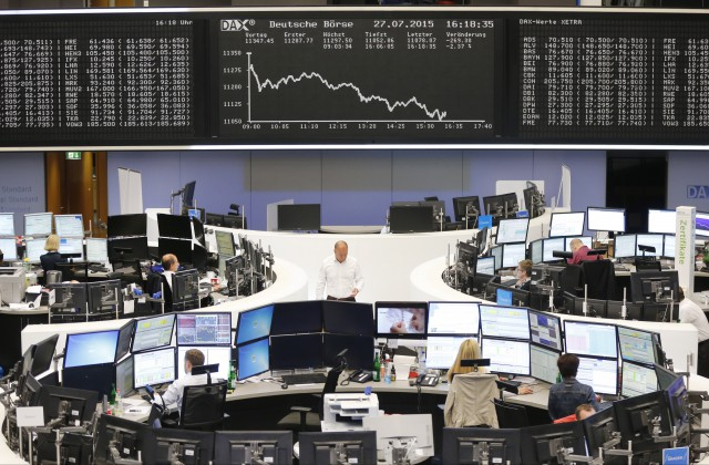 The curve of the German stock index DAX is displayed on a board at the stock market in Frankfurt, Germany