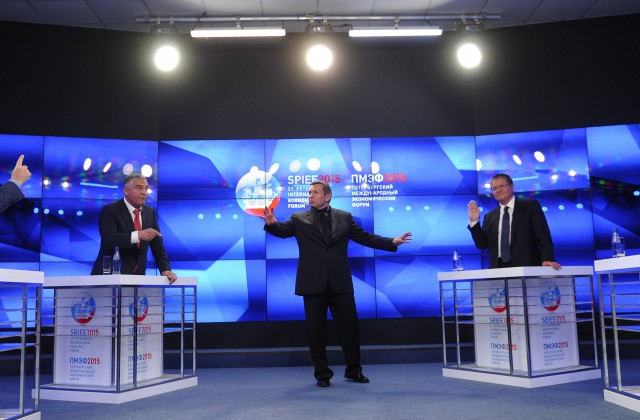 ST. PETERSBURG, RUSSIA. JUNE 19, 2015. Andrei Makarov, Chairman of Russia's State Duma Committee for Budget and Taxes, Yevgeny Tarlo, member of the Russian Federation Council Committee for Economic Policy, Russian TV presenter Vladimir Solovyov, Russian Economic Development MInister Alexei Ulyukayev and Russian State Duma First Deputy Chairman Alexander Zhukov (L-R) seen during a TV Debate titled