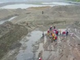 В Китае на дне реки обнаружили древний клад династии Мин